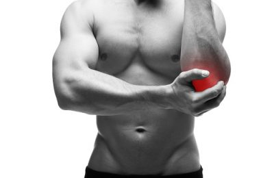 Pain in the elbow. Muscular male body. Isolated on white background with red dot. Black and white photography